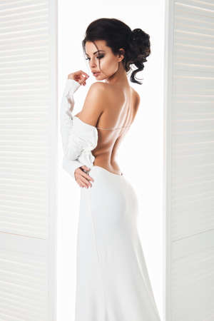 sensual woman: Beautiful woman in the white dress next door