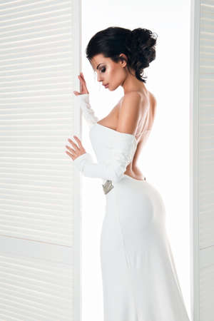 Beautiful woman in the white dress next door Stock Photo - 45137384