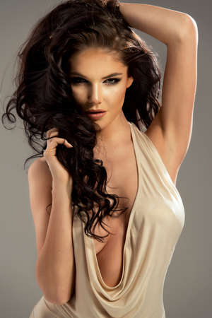 glamour nude: beautiful sensual brunette woman with long curly hair Stock Photo