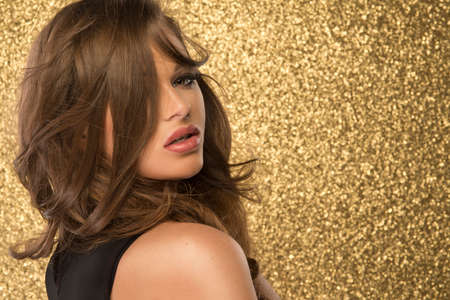 woman surprise: Magic Girl Portrait in Gold. Golden Makeup Stock Photo