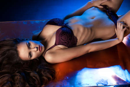 light blue lingerie: Sexual woman in lingerie over black metal background. Stock Photo