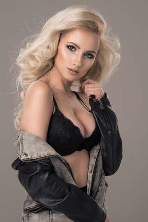 black bra: Sexy blond woman in jeans jacket