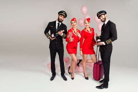 flight crew: Happy group of pilots and stewardesses