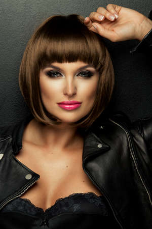 brunette woman: Sexy brunette woman in leather jacket