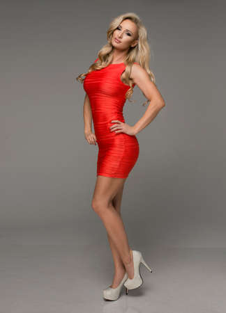 red dress: Sexy blond woman in red dress Stock Photo