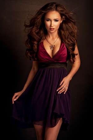 Cute woman in gorgeous dress