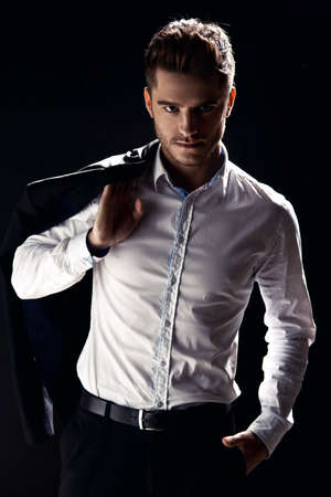 cool man: Elegant young handsome man. Studio fashion portrait.