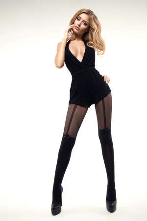 Sexy woman with long slim legs wearing tights Stock Photo