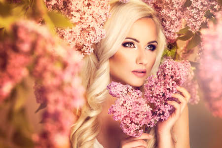 spring fashion: Beauty fashion model girl with lilac flowers Stock Photo