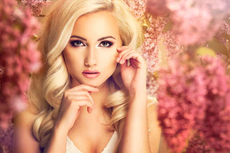 Beauty fashion model girl with lilac flowers Stock Photo - 46908916