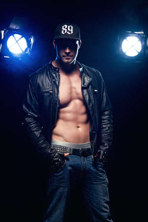nude male body: Sexy Man on Dark Background Stock Photo