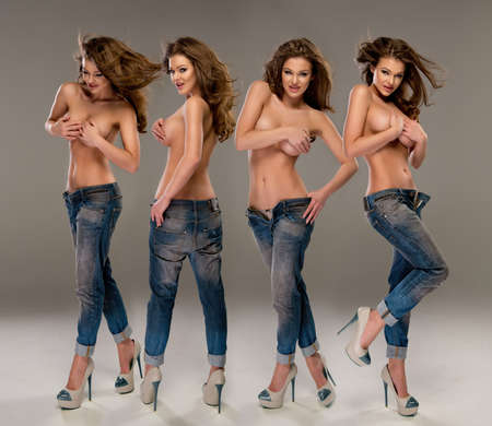 nude woman standing: Young, fit and sexy woman only in jeans. Topless