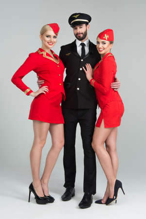 airline hostess: Happy group of pilots and stewardesses