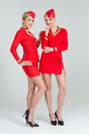 airline hostess: Two happy stewardesses