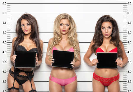 underwear: Mugshot of a beautiful three sexy young woman Stock Photo