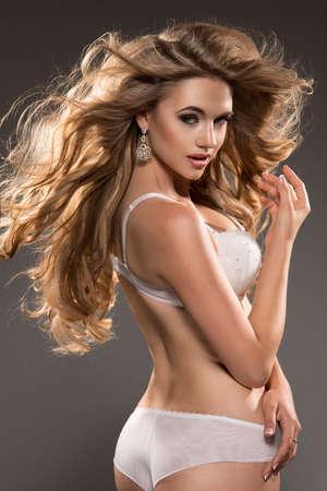 glamour nude: Young blonde woman beauty portrait studio shot