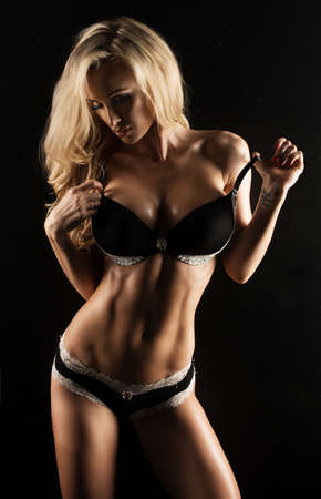 Sexy blonde Woman with sporty Body photo