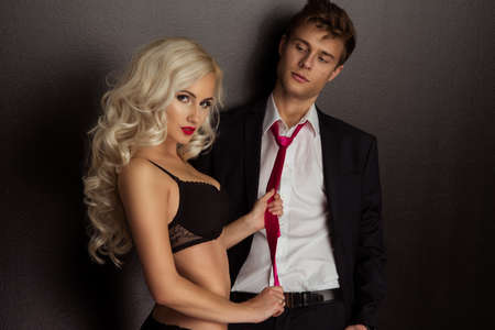 Photo of a young couple in sensual lingerie and suit Standard-Bild