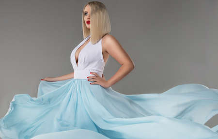 flyaway: young beauty woman in fluttering dress. Stock Photo