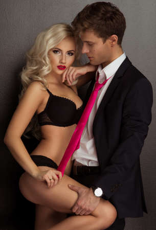 erotic male: Photo of a young couple in sensual lingerie and suit Stock Photo