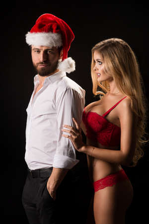 party friends: Portrait of a young couple with Santa hat
