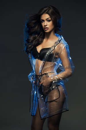 nude sexy woman: Sexy woman only in lingerie with transparent coat highlighted in blue