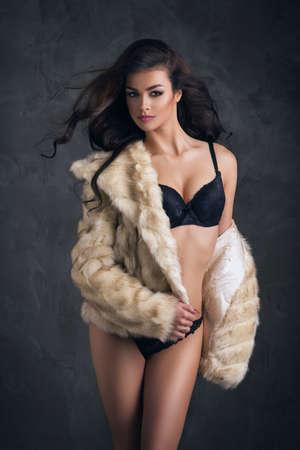 fur: Sexy brunette woman wear fur Stock Photo