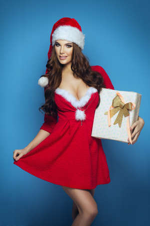 santa claus face: Beautiful sexy girl wearing santa claus clothes