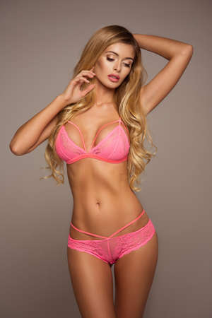 sexy hands: Sexy blond woman wear pink lingerie