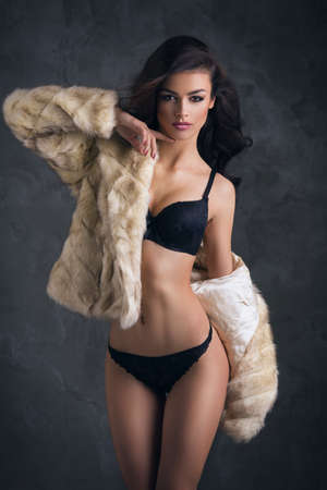 sexy fur: Sexy brunette woman wear fur Stock Photo