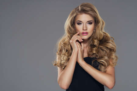 breasts erotic: Sensual beautiful blonde woman posing. Girl with long curly hair.