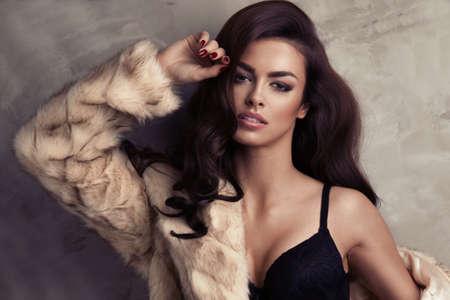 Portrait of sexy brunette woman wear fur