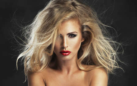 Sexy strict woman with red lips photo