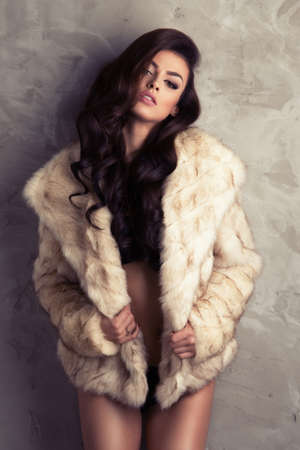 white fur: Sexy brunette woman wear fur Stock Photo