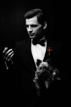 Portrait of man with dog, godfather-like character. photo