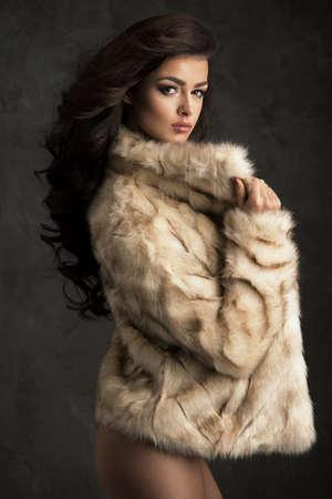 sexy fur: Sexy brunette woman wear fur Stock Photo