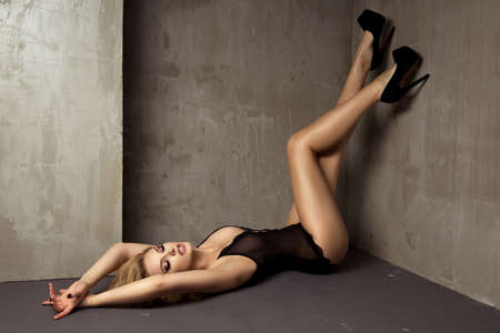 erotic woman: Sexy blonde woman in lingerie lying on floor Stock Photo