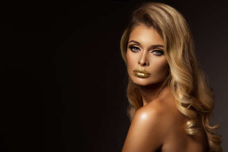 perfect face: Magic Girl Portrait in Gold. Golden Makeup Stock Photo
