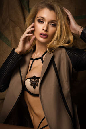 Sexy blonde woman in jacket