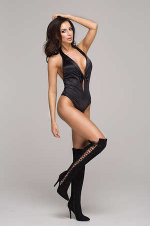 Sexy attractive brunette woman posing in fashionable lingerie in studio Stock Photo