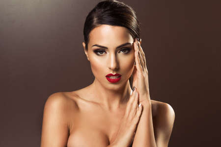 Beautiful woman with red lips looking sexy