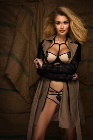 seductress: Sexy blonde woman in jacket