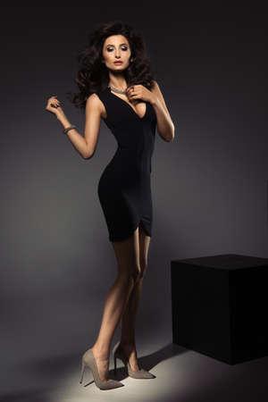 long: Cute brunette woman in gorgeous dress