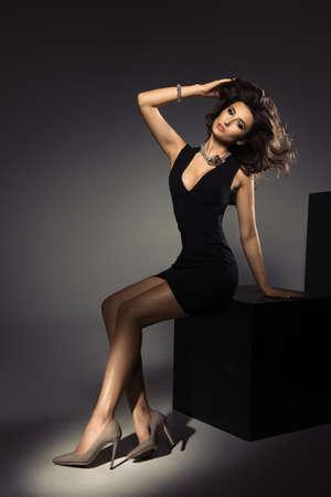 Cute brunette woman in gorgeous dress