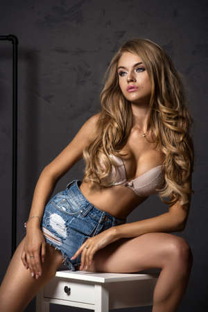 Cute blonde woman in jeans photo