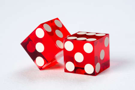 Two red dices, casino isolated on white background Stock Photo