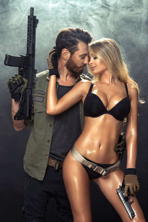 felon: An attractive young couple with guns