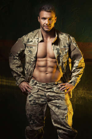Muscular man come back from army 版權商用圖片