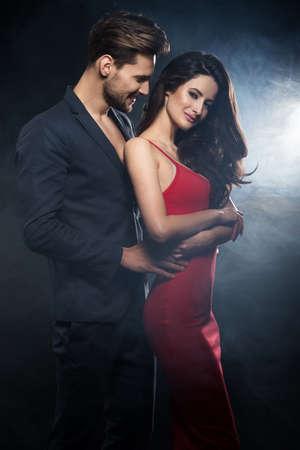 Sexy elegant couple. Woman wear re dress