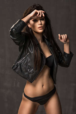 Elegant beautiful sexy woman posing in sensual lingerie, looking at camera Stock Photo